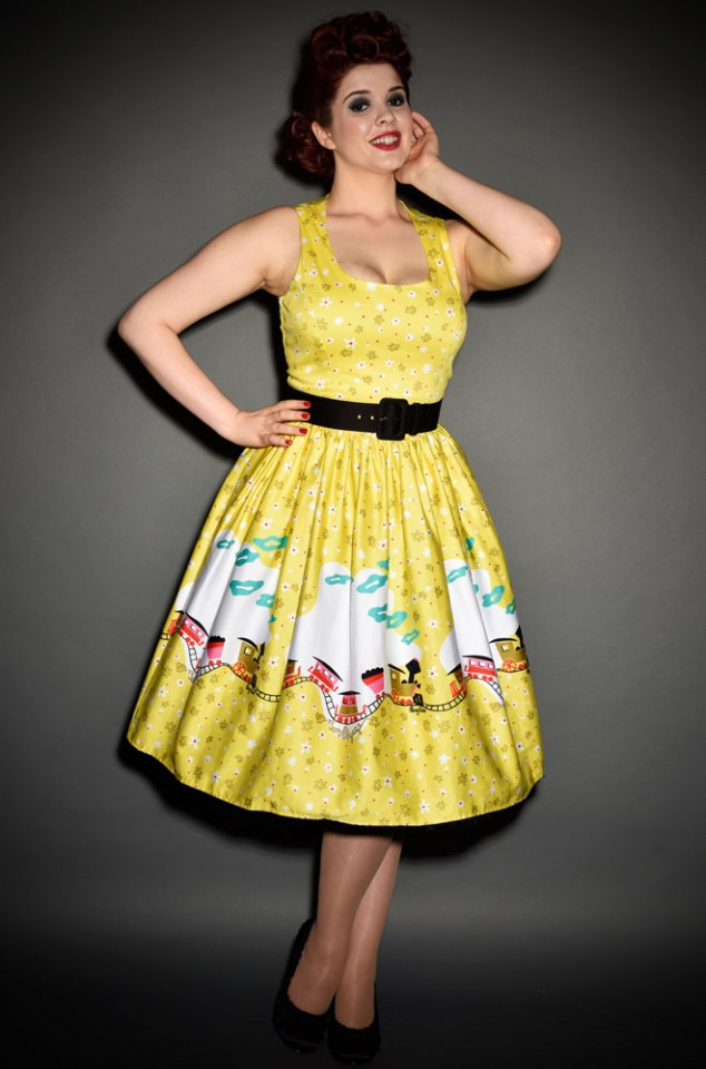 Mary Blair Train Boarder Print Aurora dress by Pinup Girl Clothing at UK Stockists, Deadly is the Female