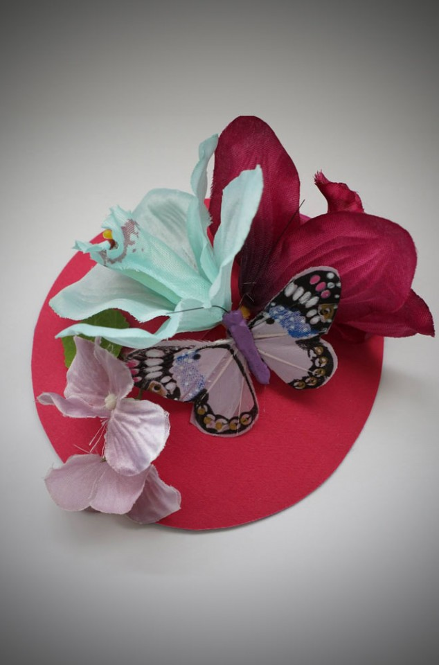 Vintage style pink fascinator hat with colourful flowers