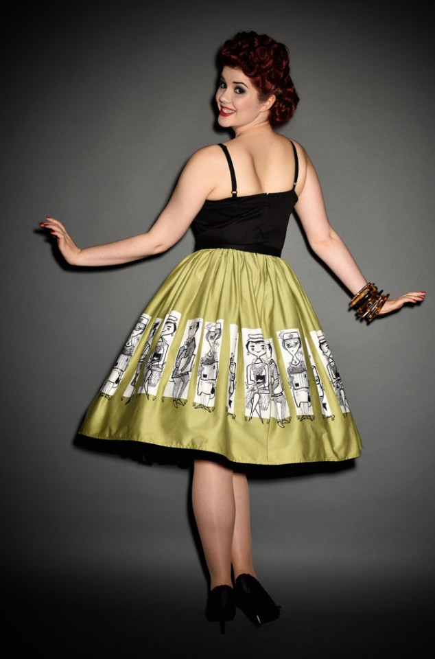 Mary Blair at Pinup Girl Clothing Jenny Dress in Commuters Print at UK stockists, Deadly is the Female