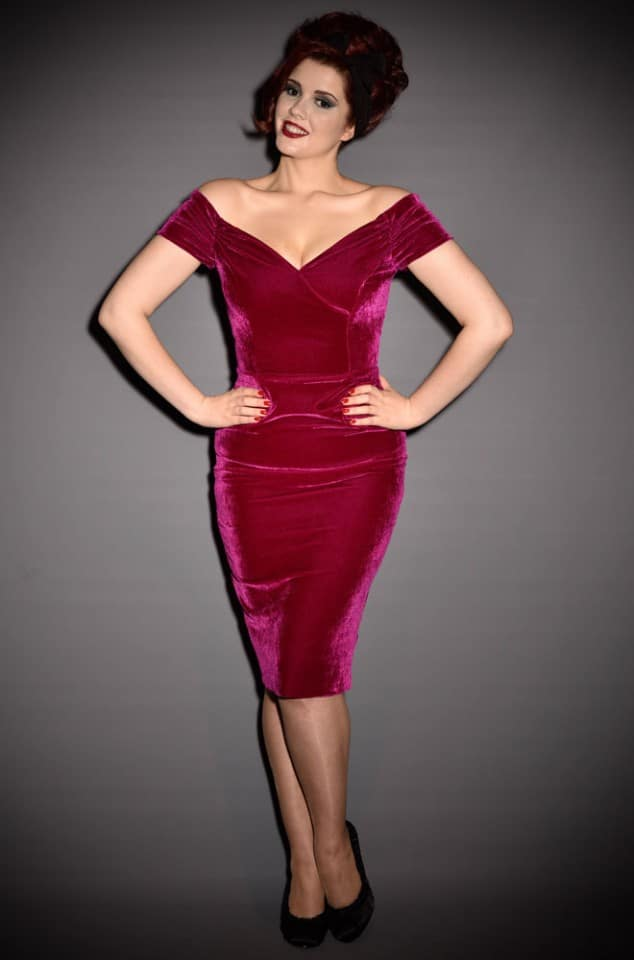 Magenta Velvet Fatale 1950's style Bardot off the shoulder wiggle dress by the Pretty Dress Company. Stunning vintage style party dress.