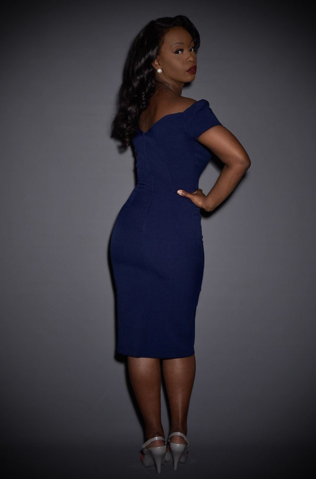 The Navy Fatale wiggle dress is a real bombshell of a dress. This fabulous off the shoulder wiggle dress is inspired by film noir & is perfect for pinups.