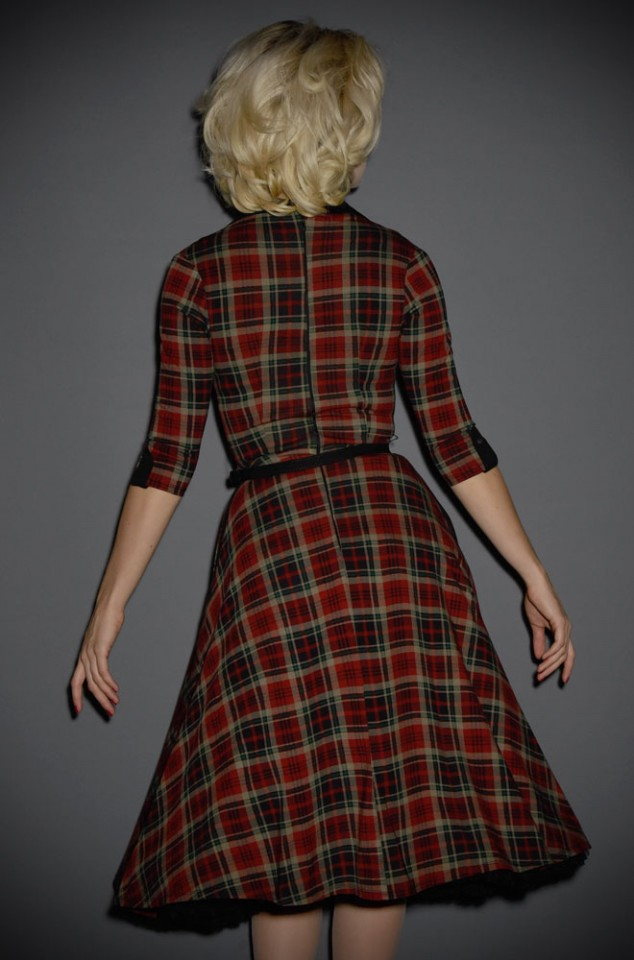 The Trudy Tartan Swing Dress is a 1950s inspired dress in tartan in burgundy red, emerald green & deep navy blue. Unique vintage at Deadly is the Female,