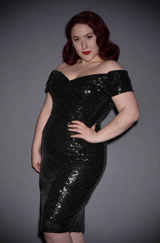 Sequin Fatale Dress in black - 1950's style stretch sequin Bardot off the shoulder Fatale wiggle dress by the Pretty Dress Company.
