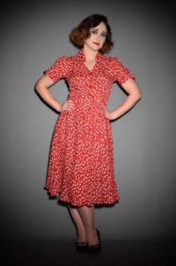 The Iris 40's Dress is a timeless vintage inspired dress with an authentic red clover print at Deadly is the Female. This dress is effortlessly classic.