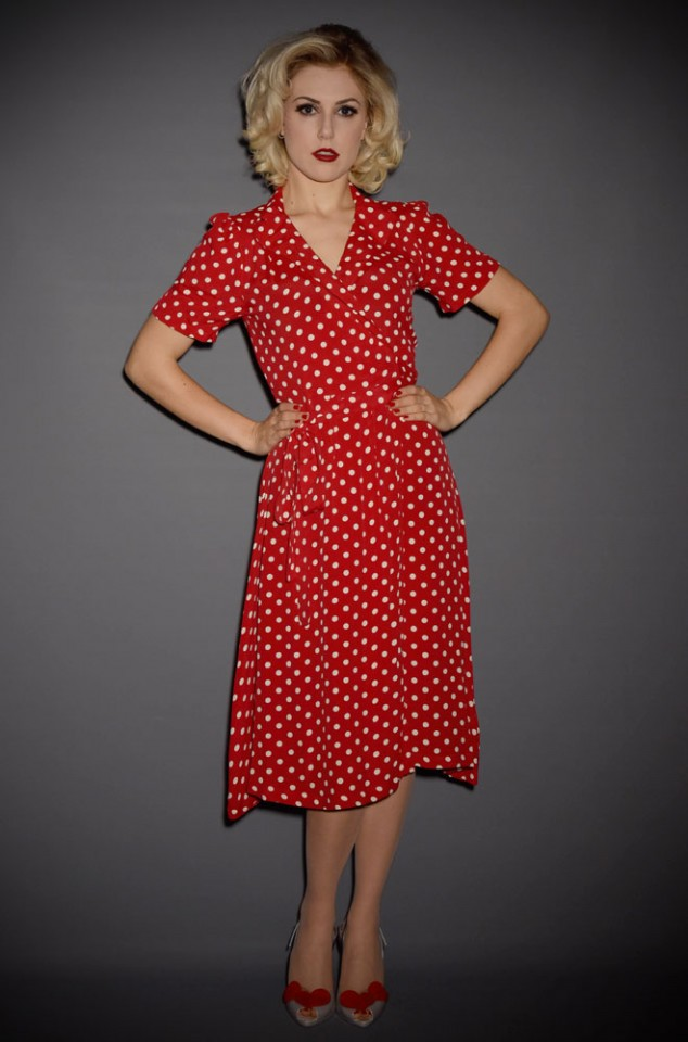 The Peggy Wrap Dress is a classic 1940's wrap dress in timeless red and white polka dots at Deadly is the Female.
