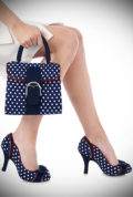 Amy is a classic heel with bags of pretty details! These navy polka dot shoes feature a bow over the toe, contrast scallop details & dainty microdot piping.