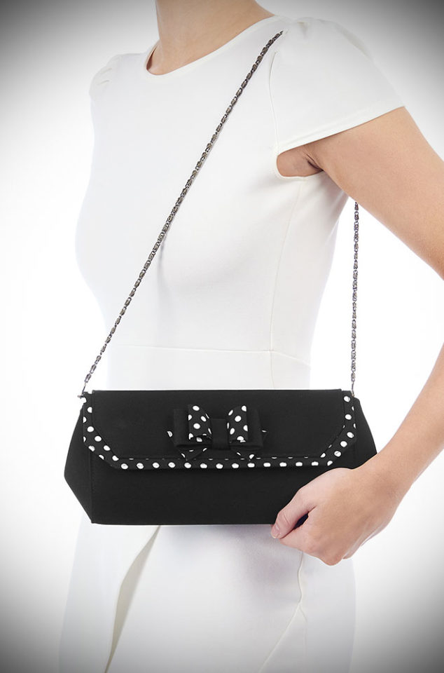 The Brighton Bag is an adorable envelope style polka dot clutch bag. The black and white polka dots are timeless & we love the cute bow detail!