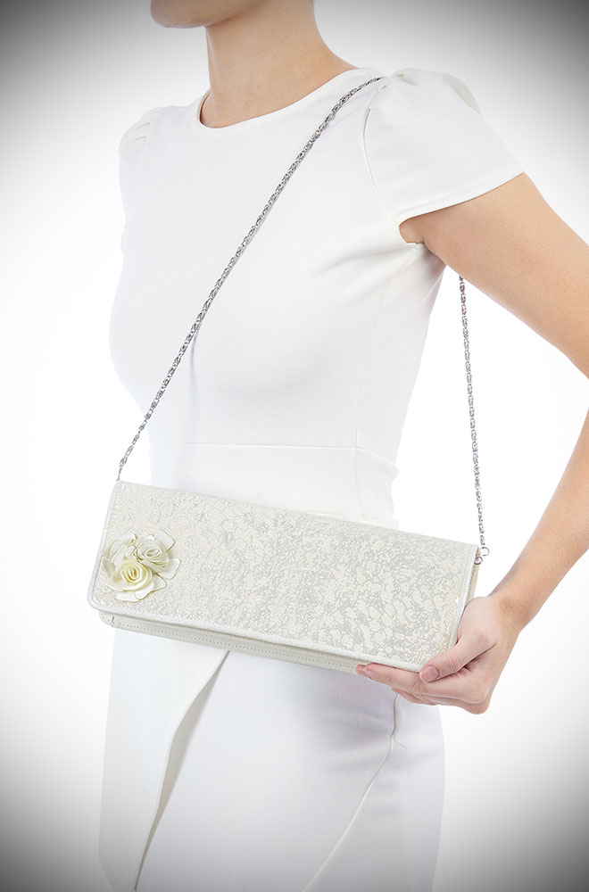 The London Bag is a silver vintage inspired bag with rose details. Paired with the matching Emily shoes this bag is oh so charming.