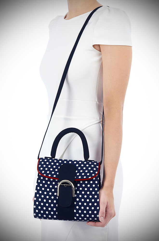 The Riva Bag is a navy polka dot bag that matches perfectly with our Amy Shoes. This dotty bag will take you from day to evening in style.