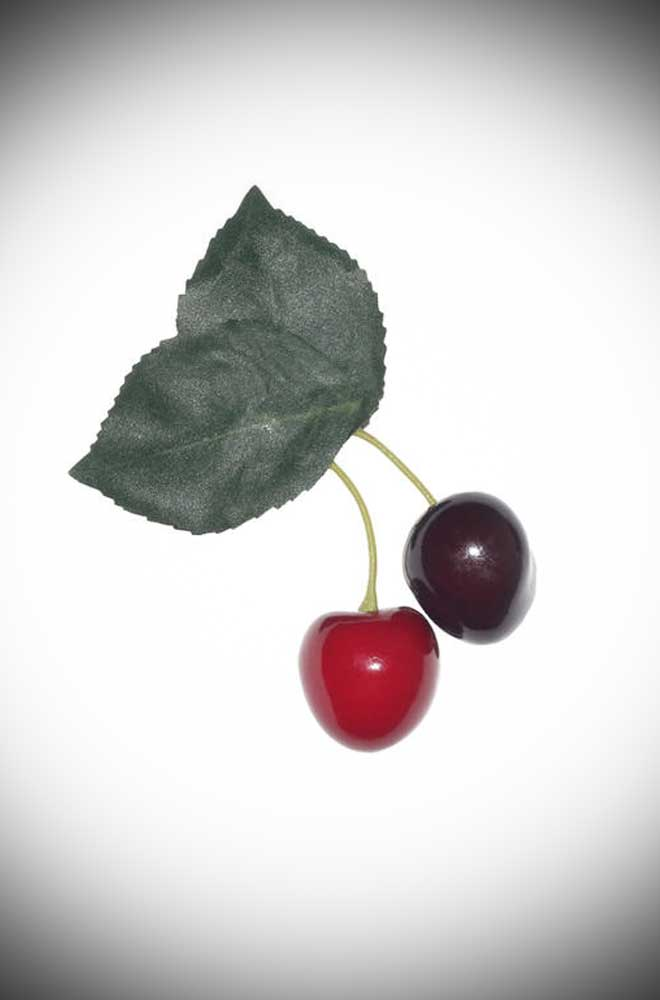 Add some instant tropical glamour to your look with this Double Cherry hair clip. Adorable pair of deep luscious red cherries attached to two green leaves.
