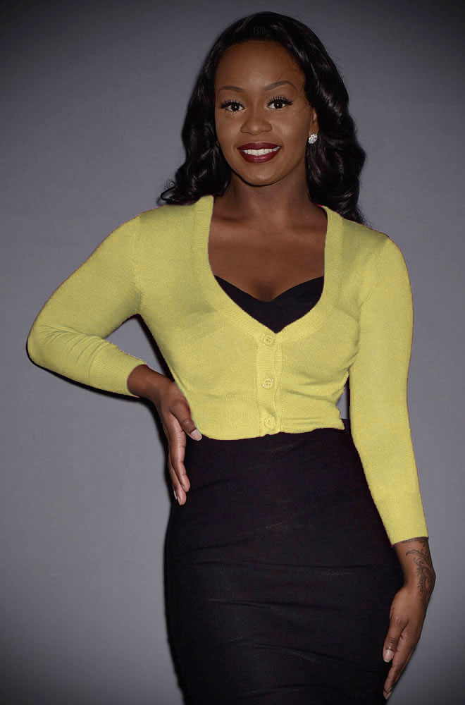 This Baby Yellow Cropped Cardigan is a wardrobe essential. Featuring a V neckline, 3/4 length sleeves & 3 buttons. Perfect for pinup girls & vintage gals.