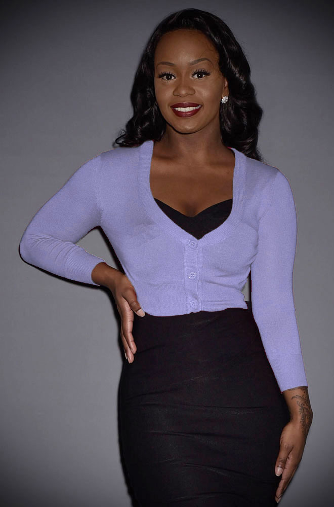 This Lilac Cropped Cardigan is a wardrobe essential.Featuring a V neckline, 3/4 length sleeves & neat buttons. Perfect for pinup girls & vintage gals.