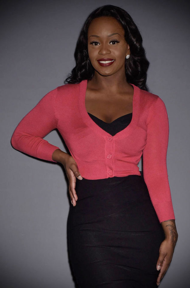 This Rose Pink Cropped Cardigan is a wardrobe essential. Featuring a V neckline, 3/4 length sleeves & neat buttons. Perfect for pinup girls & vintage gals.