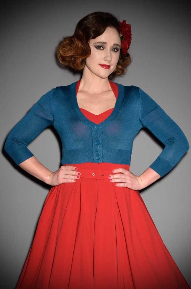 This Teal Cropped Cardigan is a wardrobe essential. Featuring a V neckline, 3/4 length sleeves & 3 neat buttons. Perfect for pinup girls & vintage gals.