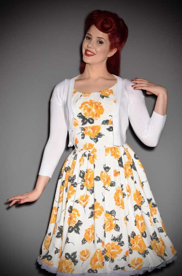 This White Cropped Cardigan is a wardrobe essential. Featuring a V neckline, 3/4 length sleeves & 3 neat buttons. Perfect for pinup girls & vintage gals.