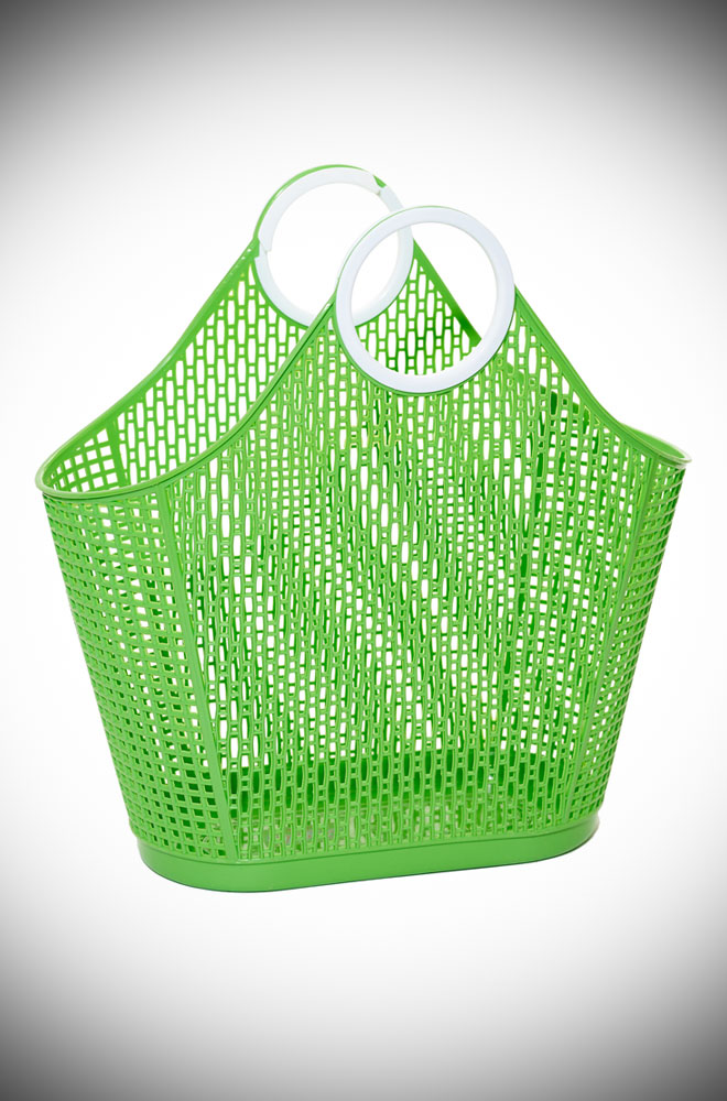 Green Fiesta Shopping Bag in striking hot pink recyclable plastic bag. A remake of a retro classic perfect for popping to the shops or beach.