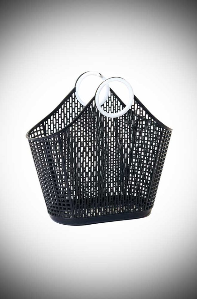 Black Fiesta Shopping Bag is a recyclable plastic bag. A remake of a retro classic perfect for popping to the shops or beach.