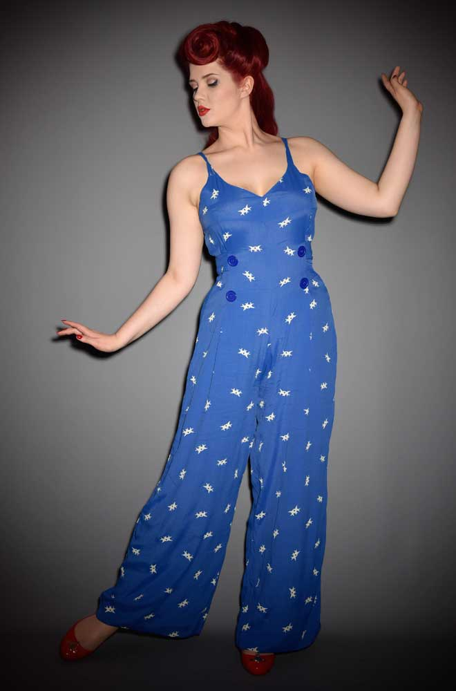 Charlotte is a vintage jump suit in a beautiful bluebird print. Featuring a nipped in waist & wide leg trousers for a classic 40's Hollywood glamour feel.