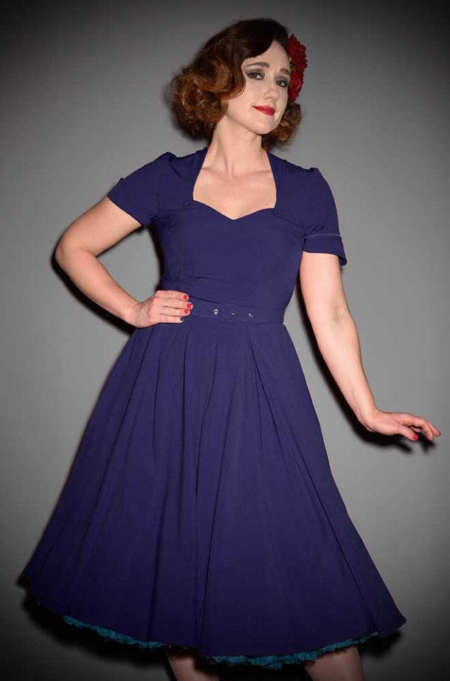 The Stella dress is a navy blue vintage style swing dress by Miss Candyfloss at UK stockists, Deadly is the Female. Housewife Chic at it's very best.