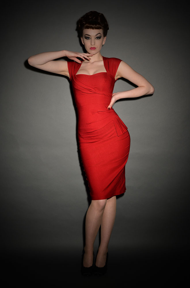 The Stop Staring Red Uma Dress is a classy but sassy wiggle dress, designed to flatter and enhance your curves.