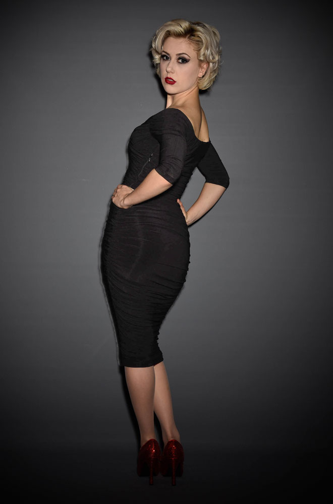 The Black Monica Dress is the ultimate 50's style wiggle dress, carefully walking the line between sultry, demure and all out sex kitten! By Laura Byrnes for Pinup Girl Clothing