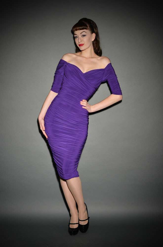 The Purple Monica Dress is the ultimate 50's style wiggle dress, carefully walking the line between sultry, demure and all out sex kitten! This gorgeously ri