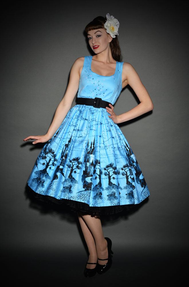 50's style Blue Castle Print Aurora Dress by Pin Up Girl Clothing at Deadly is the Female. We are proud UK stockists of Pinup Couture.