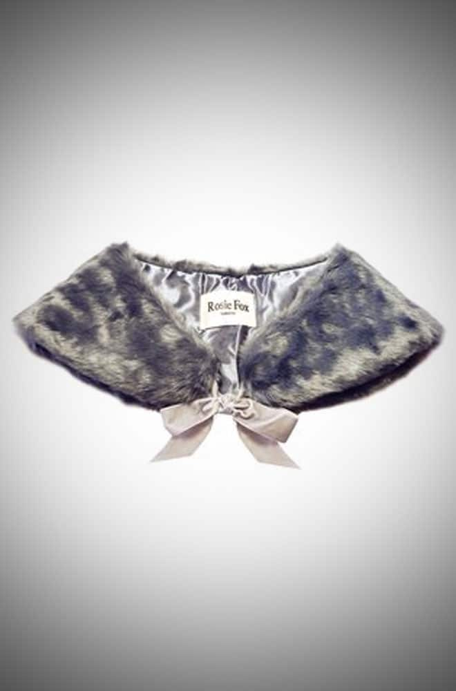 A gorgeously soft faux fur stole with a velvet-effect ribbon and silky lining.