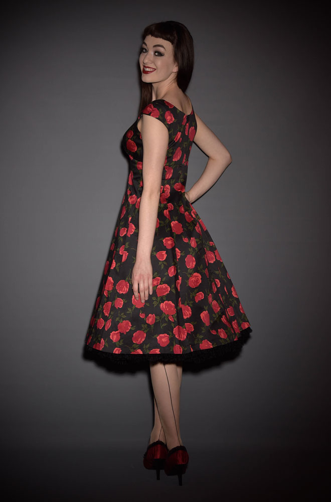 UK stockists of Retrospec'd Clothing. Introducing the Empire Dress in Casablanca print, a classic 50's style floral dress in black and red.
