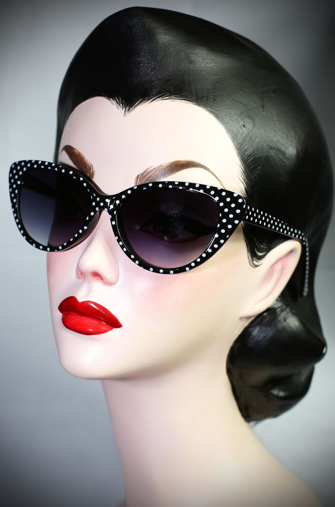 The Kitty sunglasses are black polka dot 50's cats eye sunglasses at Deadly is the Female. Effortlessly add some pinup glamour to your day!