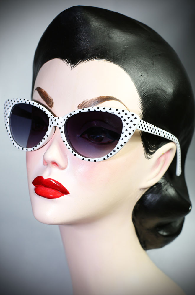 The Kitty sunglasses are white polka dot 50's cats eye sunglasses at Deadly is the Female. Effortlessly add some pinup glamour to your day!