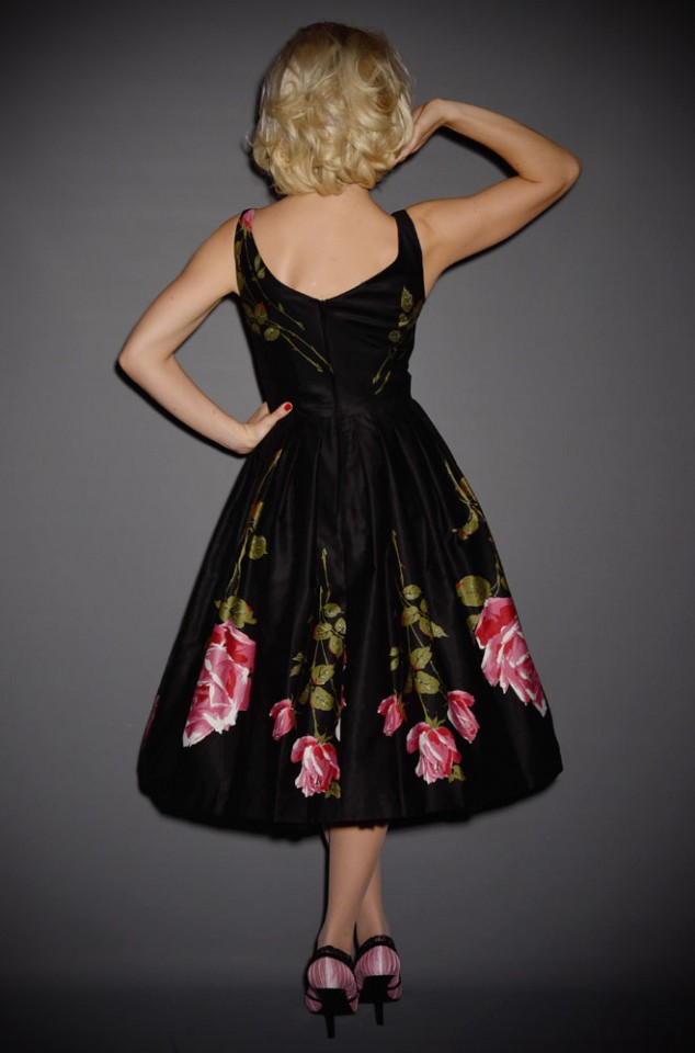 UK stockists of Retrospec'd Clothing. Introducing the Elizabeth dress. A romantic 50s style dress in black and pink rose print.