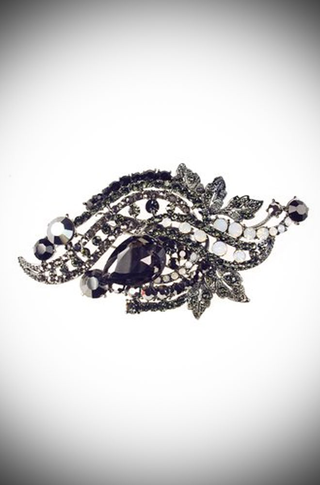 Vintage style Jet brooch & hair clip with sliver coloured metal and black stones. The perfect finishing touch to any pinup outfit.