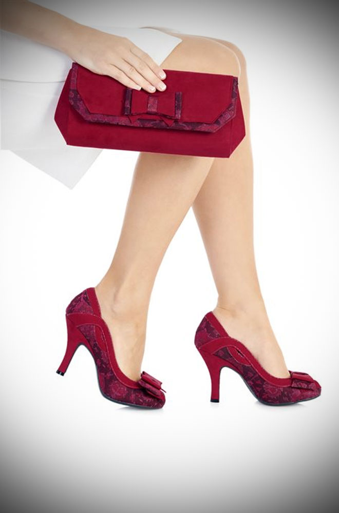 The Brighton Bag is a striking red envelope clutch bag with contrast tapestry jacquard detail and bow!