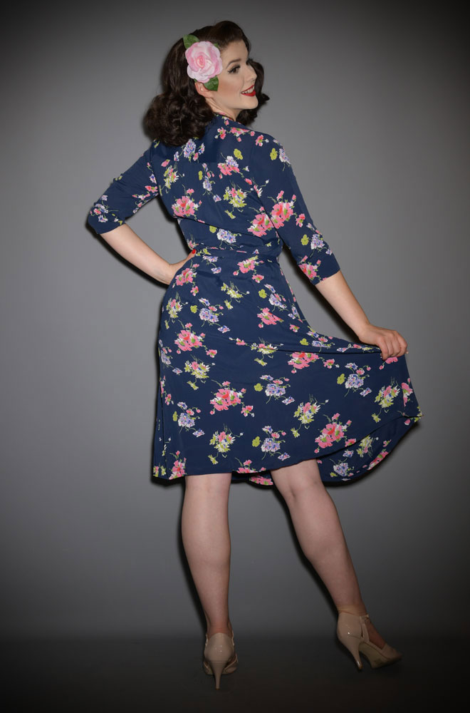 The Loretta Wrap Dress is a classic 1940's wrap dress with 3/4 length sleeves in a striking navy floral print at Deadly is the Female.
