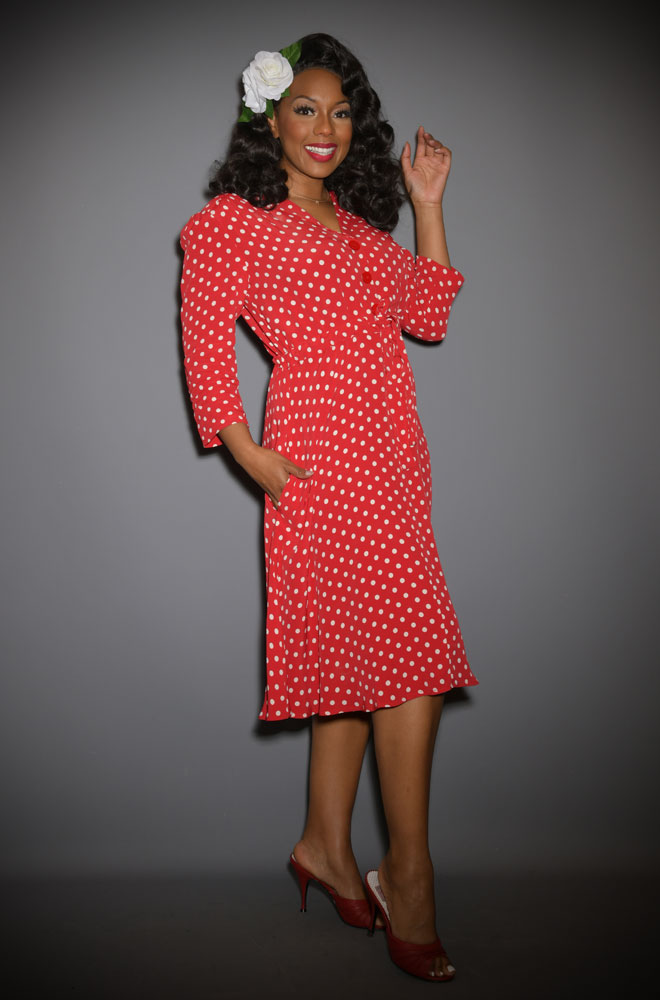 The Milly Dress is a classic 40s inspired dress in timeless polka dots. Elegant and chic, this understated dress also has a sultry feel.