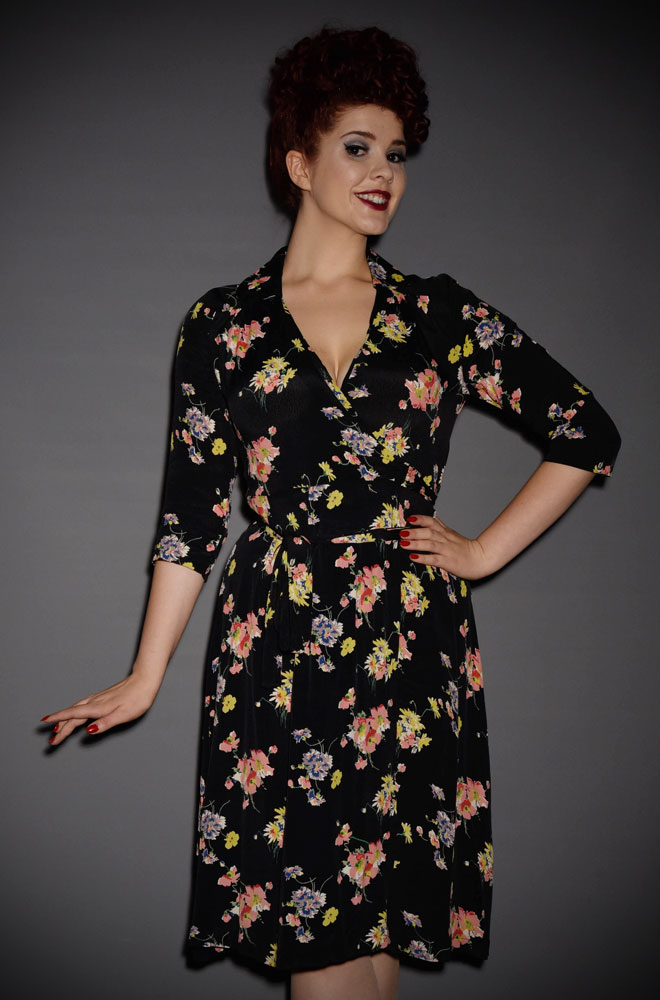 The Loretta Wrap Dress is a classic 1940's wrap dress with 3/4 length sleeves in a striking black floral print at Deadly is the Female.