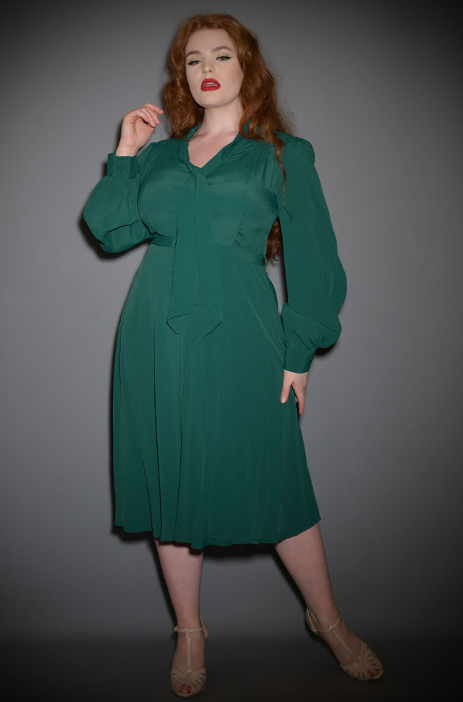 The Eva Dress is a classic 40s inspired dress in a stunning shade of forest green. Elegant and chic, this understated dress has a sultry feel.