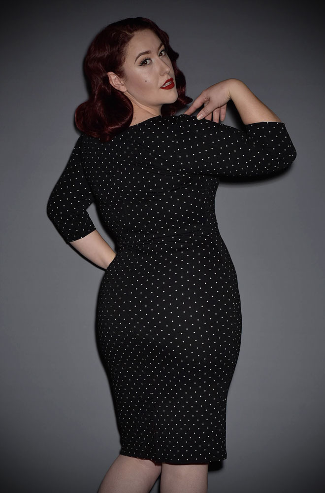 The black & white dot Mod Wiggle Dress is a fabulous 60's style dress inspired by the classic spy films of the era! By Unique vintage at UK stockists, Deadly is the Female.