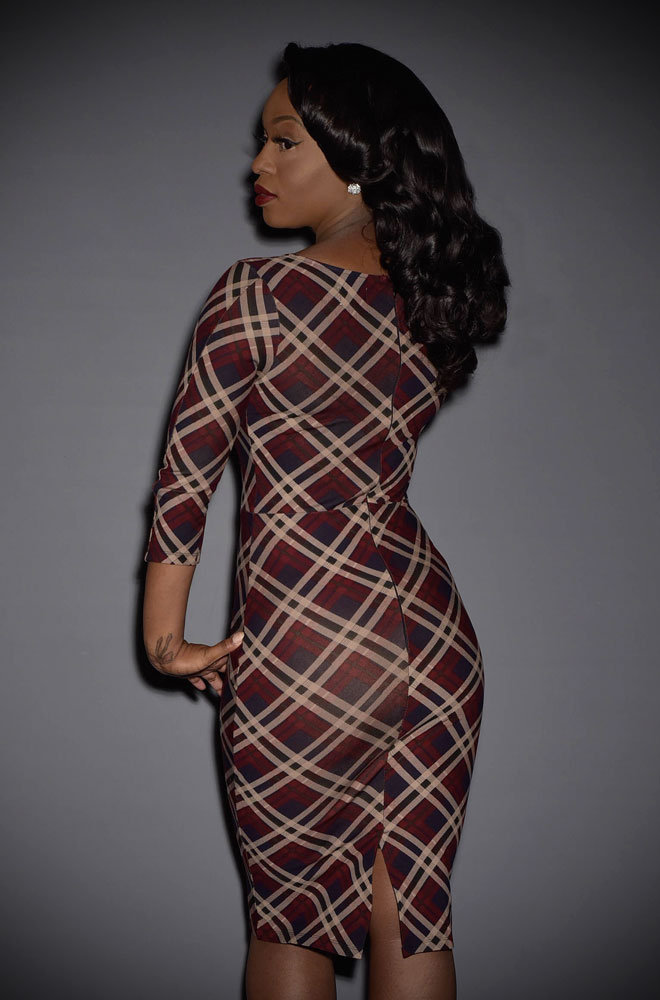 The navy, tan & burgund Mod Tartan Wiggle Dress is a dress inspired by spy films of the 60's. By Unique vintage at UK stockists, Deadly is the Female