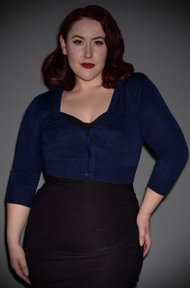 This classic Navy Cropped Cardigan is a wardrobe essential. Featuring a V neck line, 3/4 length sleeves & 3 neat buttons.