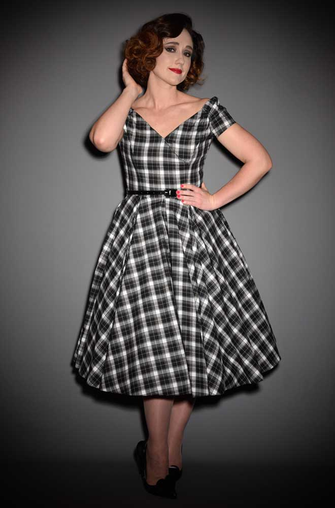 Blending femme fatale with a 50's silhouette - the Black Tartan Fatale Prom dress. Deadly is the Female are stockists of The Pretty Dress Company.