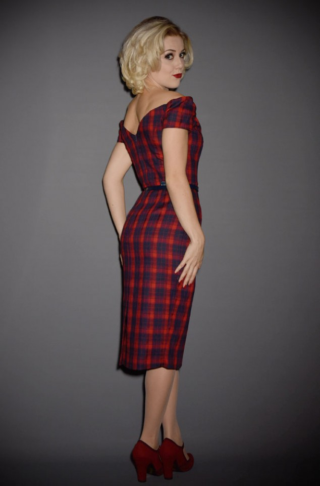 The Fatale red and navy tartan wiggle dress is a real bombshell of a dress. This fabulous off the shoulder wiggle dress is perfect for pinup girls.