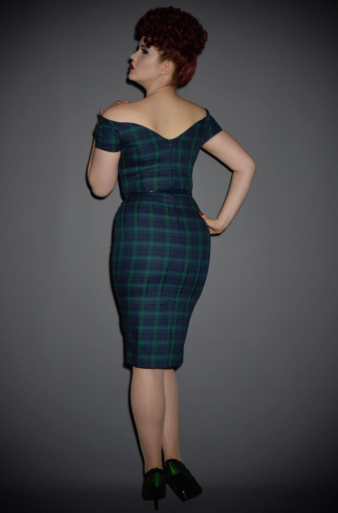 The Fatale tartan wiggle dress in forest and navy is a real bombshell of a dress. This fabulous off the shoulder wiggle dress is perfect for pinup girls.