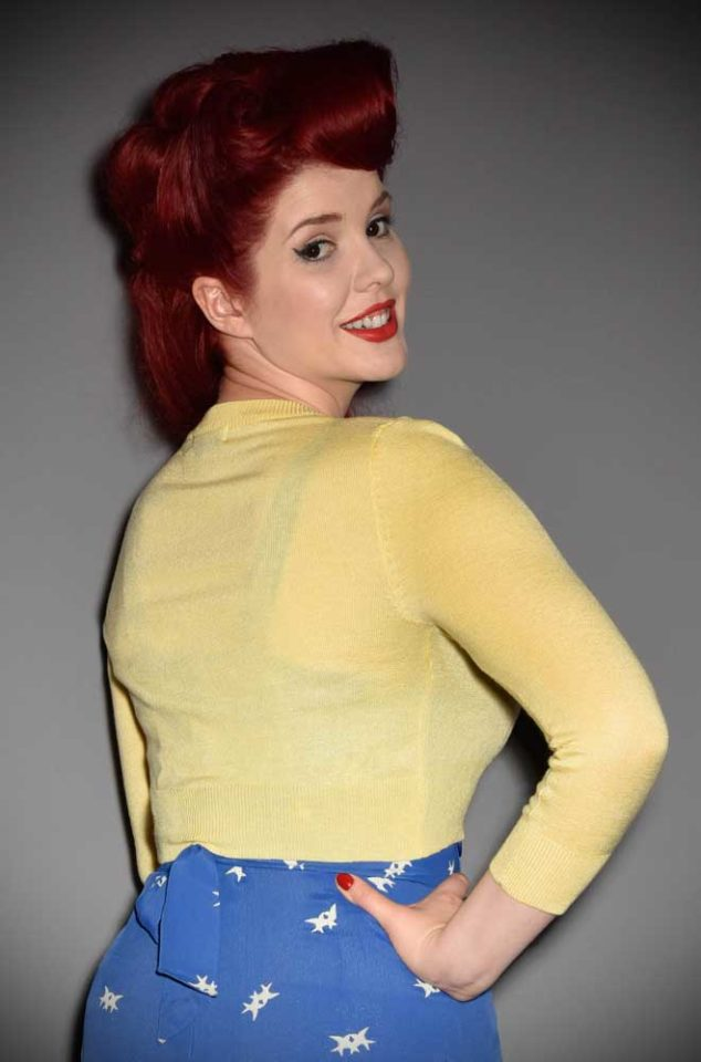 This Baby Yellow Cropped Cardigan is a wardrobe essential.Featuring a V neckline, 3/4 length sleeves & 3 buttons. Perfect for pinup girls & vintage gals.