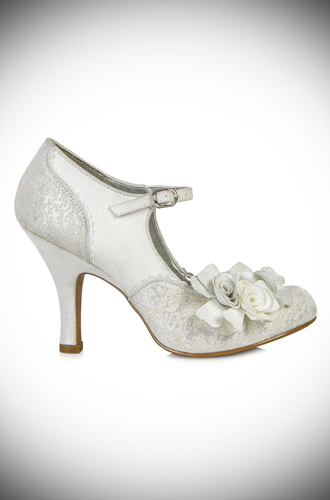 The Emily silver shoes are medium height closed court shoes with ankle bar strap and rose details. They are just perfect for weddings and summer parties!