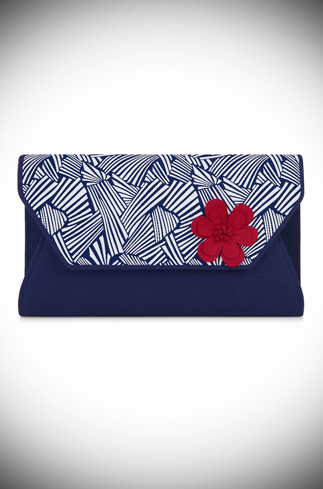 The Naples Bag is a navy and white deco style bag with a red rose detail. This stylish envelope bag will take you from day to evening in style.