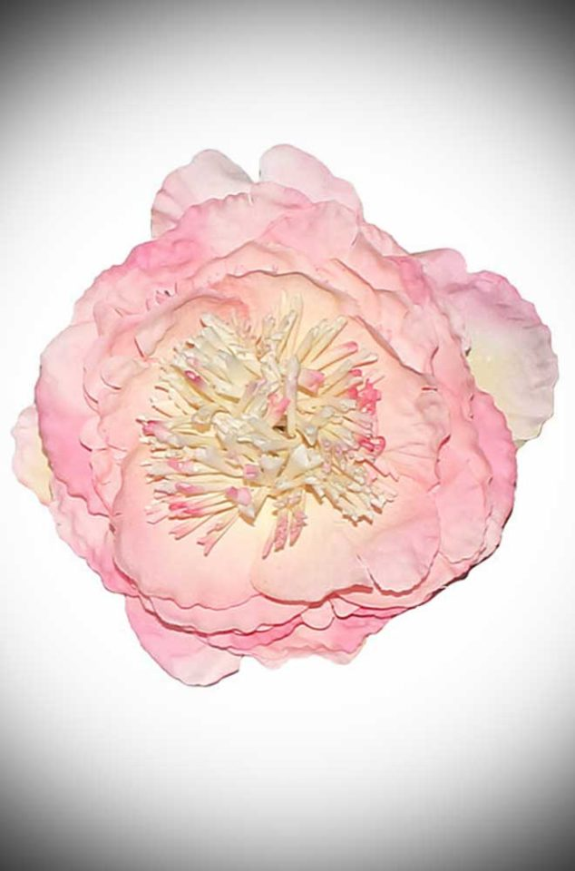 Add some instant vintage glamour to your look with this Baby Pink Peony Hair Flower. A classic pale pink peony flower mounted on a small hair clip.