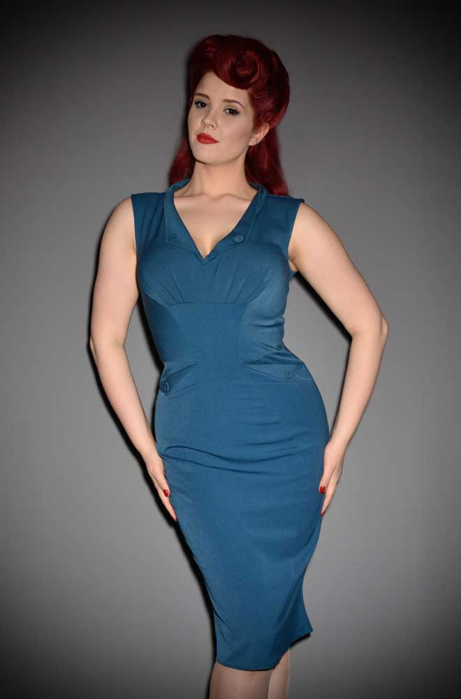 The Erika Wiggle Dress is a teal pencil dress dress by Miss Candyfloss at UK stockists, Deadly is the Female. Housewife Chic at it's very best.
