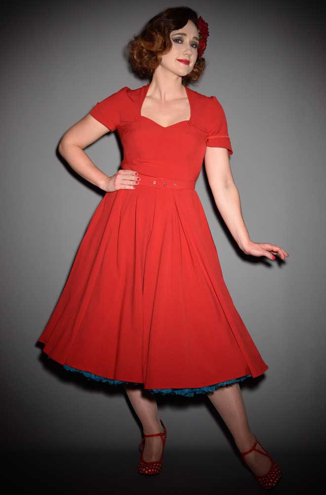The Stella-Rose dress is a pretty red vintage style swing dress by Miss Candyfloss at UK stockists, Deadly is the Female. Housewife Chic at it's very best.